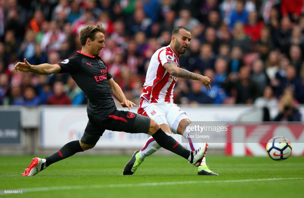 Jese of Stoke City scores his sides first goal as Nacho Monreal of Arsenal attempts to block during the Premier League match between Stoke City and Arsenal at Bet365 Stadium on August 19, 2017 in Stoke on Trent, England.