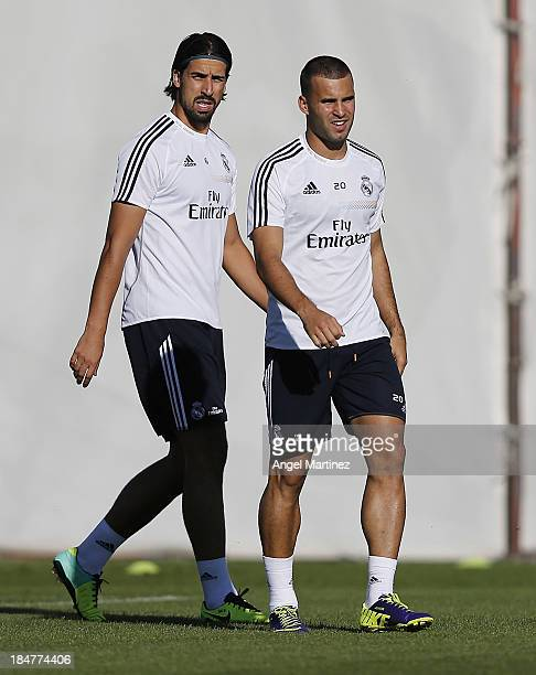 Jese Rodriguez and Sami Khedira of Real Madrid attend a training session at Valdebebas training ground on October 16 2013 in Madrid Spain