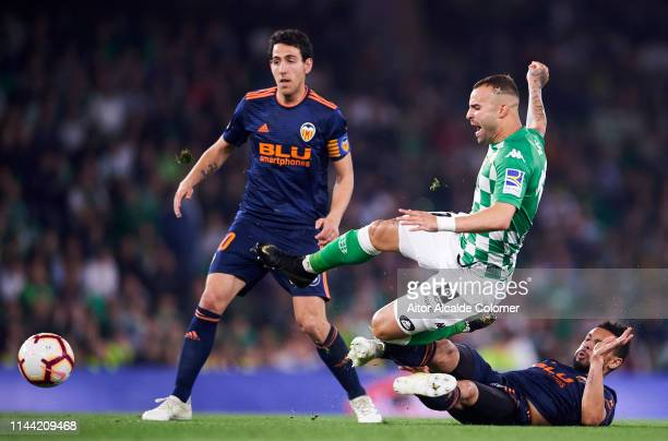 Jese Rodriguez of Real Betis Balompie duels for the ball with Francis Coquelin of Valencia CF during the La Liga match between Real Betis Balompie...