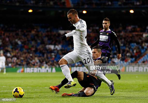 Jese Rodriguez of Real Madrid and Gilberto García Alcatraz of Valladolid CF compete for the ball during the La Liga match between Real Madrid and...