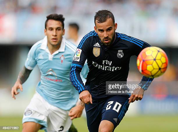 Jese Rodriguez of Real Madrid and Hugo Mallo of Celta de Vigo compete for the ball during the La Liga match between Celta de Vigo and Real Madrid CF...