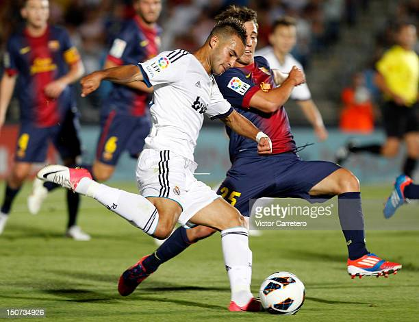 Jese Rodriguez of Real Madrid Castilla duels for the ball with Alejandro Grimaldo of Barcelona B during the La Liga Adelante match between Real...