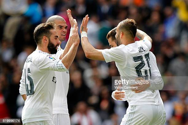 Jese Rodriguez of Real Madrid celebrates with his teammates after scoring his team's fourth goal during the La Liga match between Real Madrid CF and...