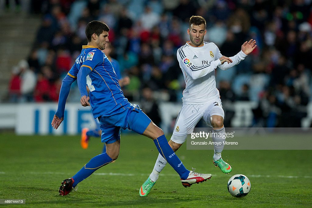 Jese Rodriguez (R) of Real Madrid CF competes for the ball with Lisandro Ezequiel Lopez (L) of Getafe CF during the La Liga match between Getafe CF and Real Madrid CF at Coliseum Alfonso Perez on February 16, 2014 in Getafe, Spain.