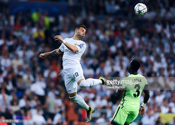 Jese Rodriguez of Real Madrid CF heads the ball during the UEFA Champions League Semi Final second leg match between Real Madrid and Manchester City...