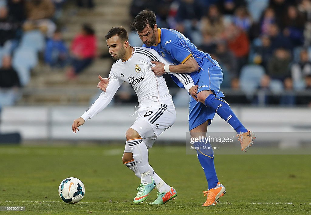 Jese Rodriguez of Real Madrid competes for the ball with Juan Valera of Getafe during the La Liga match between Getafe and Real Madrid at Coliseum Alfonso Perez on February 16, 2014 in Getafe, Spain.