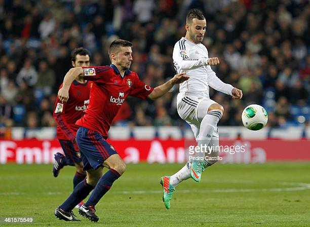 Jese Rodriguez of Real Madrid competes for the ball with Oier Sanjurjo of Osasuna during the Copa del Rey round of 16 first leg match between Real...