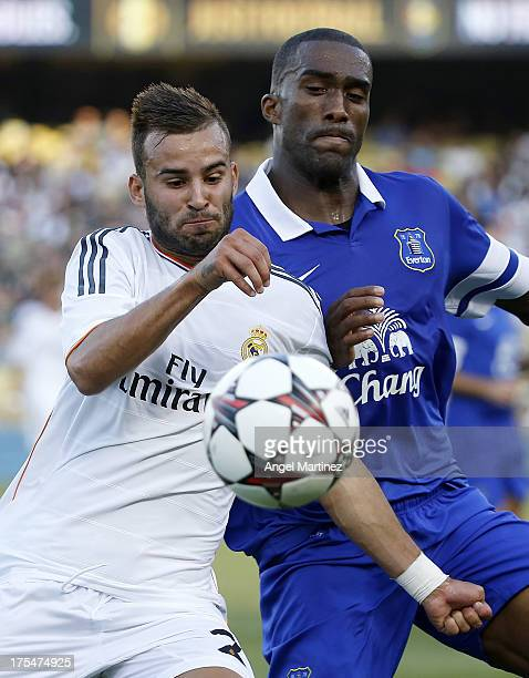 Jese Rodriguez of Real Madrid competes for the ball with Sylvian Distin of Everton during the International Champions Cup 2013 match between Everton...