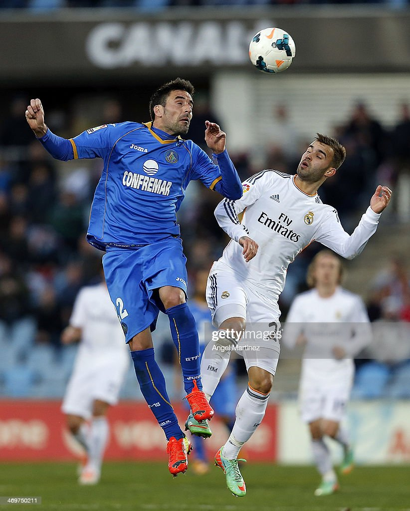Jese Rodriguez of Real Madrid competes for the ball withJuan Rodriguez of Getafe during the La Liga match between Getafe and Real Madrid at Coliseum Alfonso Perez on February 16, 2014 in Getafe, Spain.