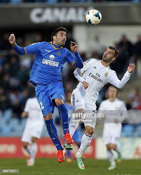Jese Rodriguez of Real Madrid competes for the ball withJuan Rodriguez of Getafe during the La Liga match between Getafe and Real Madrid at Coliseum...