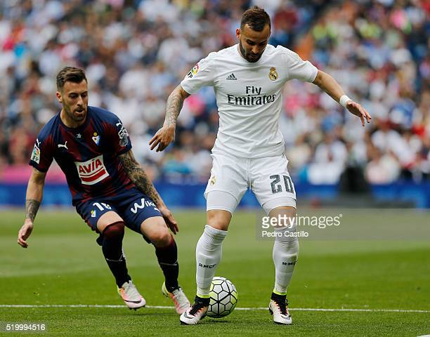 Jese Rodriguez of Real Madrid duels for the ball with Antonio Luna of SD Eibar during the La Liga match between Real Madrid CF and SD Eibar at...