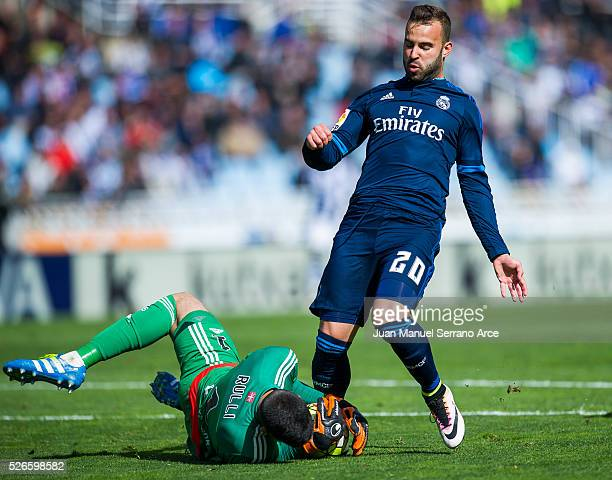 Jese Rodriguez of Real Madrid duels for the ball with Geronimo Rulli of Real Sociedad during the La Liga match between Real Sociedad de Futbol and...
