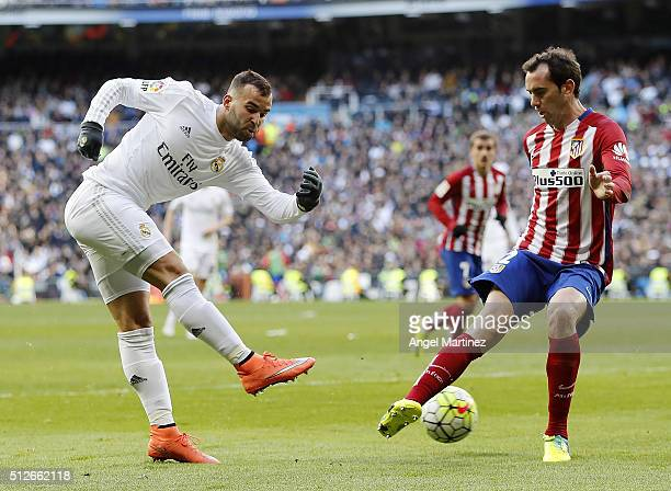 Jese Rodriguez of Real Madrid takes a shot under pressure from Diego Godin of Club Atletico de Madrid during the La Liga match between Real Madrid CF...