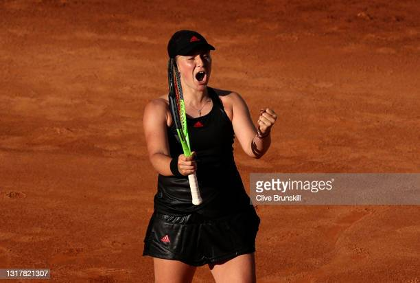 Jesena Ostapenko of Latvia celebrates match point in their ladies singles third round match against Angelique Kerber of Germany during Day Six of the...