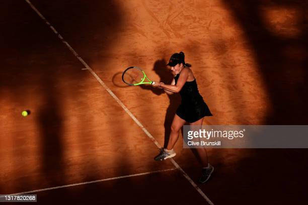 Jesena Ostapenko of Latvia plays a backhand in their ladies singles third round match against Angelique Kerber of Germany during Day Six of the...