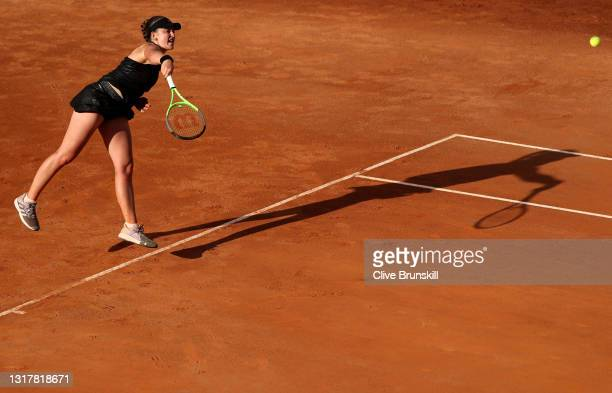 Jesena Ostapenko of Latvia serves in their ladies singles third round match against Angelique Kerber of Germany during Day Six of the Internazionali...
