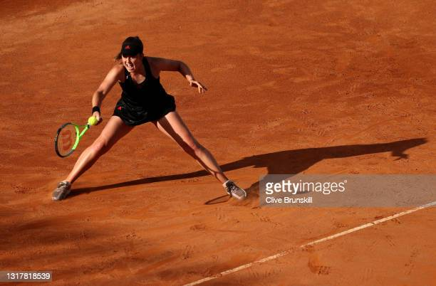 Jesena Ostapenko of Latvia stretches for a forehand in their ladies singles third round match against Angelique Kerber of Germany during Day Six of...