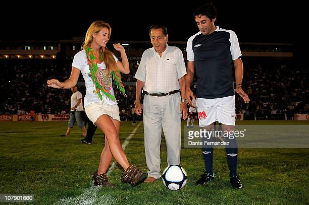 Jesica Cirio Alcides Ghiggia and Enzo Franchescoli attend a charitable AllStars Game featuring retired Uruguayan players at the Campus Stadium on...