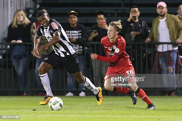 Jesiel of Atletico Mineiro chases the ball against Schreck of Bayer Leverkusen at ESPN Wide World of Sports Complex on January 11 2017 in Kissimmee...
