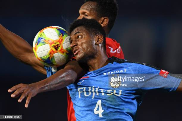 Jesiel of Kawasaki Frontale and Jo of Nagoya Grampus compete for the ball during the JLeague J1 match between Kawasaki Frontale and Nagoya Grampus at...