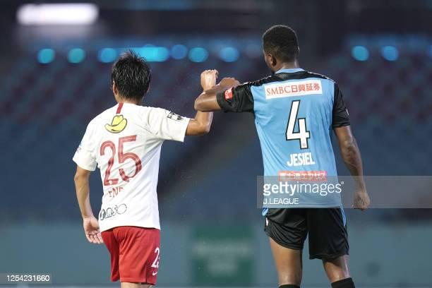 Jesiel of Kawasaki Frontale and Yasushi Endo of Kashima Antlers elbow bumps after the J.League Meiji Yasuda J1 match between Kawasaki Frontale and...