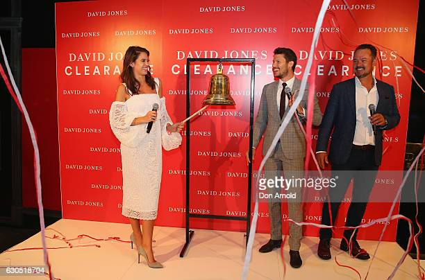 Jesinta Campbell rings the bell as Jason Dundas and David Collins look on during the Boxing Day sales on December 26, 2016 in Sydney, Australia....