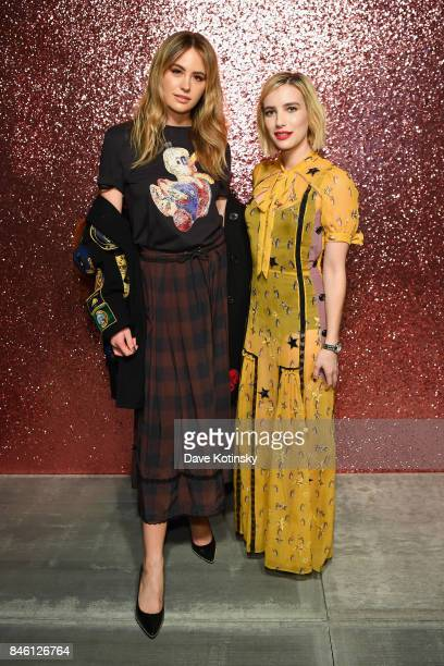 Jesinta Franklin and Emma Roberts poses for a portrait during Coach Spring 2018 Fashion Show during New York Fashion Week at Basketball City Pier 36...