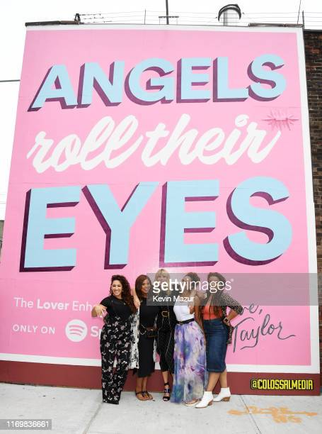 Jeslyn Eliotte Nicole Taylor Swift Melanie Nyema and Kamilah Marshall pose with Spotify Mural on Album Release Day at Kent Avenue and South 1st...
