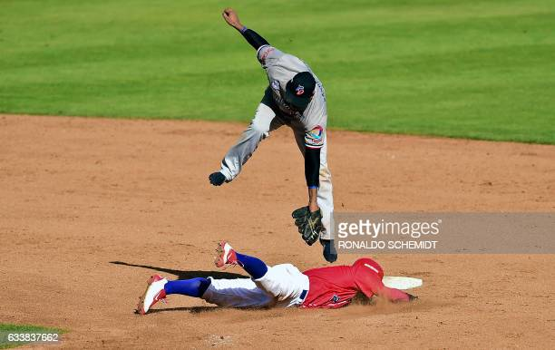 Jesmuel Valentin of Criollos de Caguas of Puerto Rico slides safe in second base during a Caribbean Baseball Series match against Tigres del Licey of...