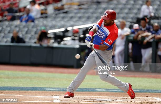 Jesmuel Valentin of Puerto Rico's Criollos de Caguas bats against Venezuela's Caribes de Anzoategui during the Caribbean Baseball Series at Charros...