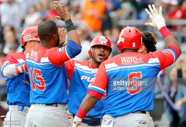 Jesmuel Valentin of Puerto Rico's Criollos de Caguas celebrates with teammates their passage to the final match against Venezuela's Caribes de...