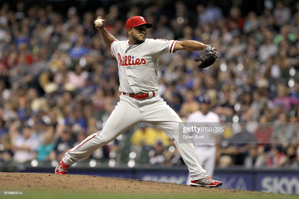 Jesmuel Valentin #9 of the Philadelphia Phillies pitches in the eighth inning against the Milwaukee Brewers at Miller Park on June 15, 2018 in Milwaukee, Wisconsin.