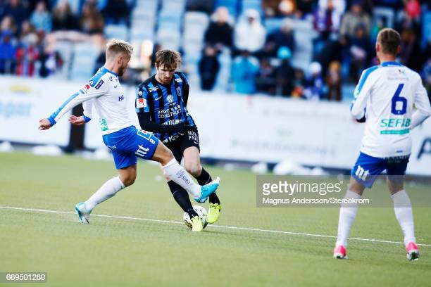 Jesper Arvidsson and Nicklas Barkroth during the Allsvenskan match between IFK Norrkoping and IF Sirius FK at Ostgotaporten on April 17 2017 in...