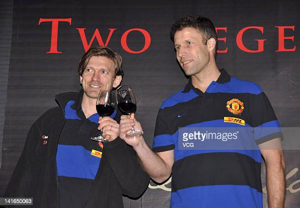 Jesper Blomqvist and Ronny Johnsen of Manchester United FC attend a commercial event for a wine brand on March 20 2012 in Shanghai China