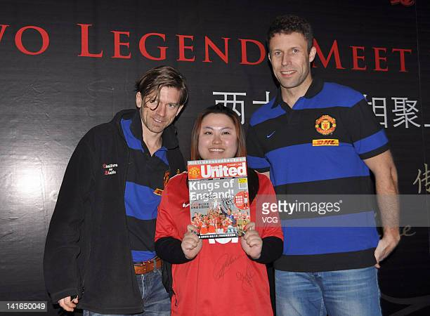 Jesper Blomqvist and Ronny Johnsen of Manchester United FC pose with a fan as they attend a commercial event for a wine brand on March 20 2012 in...