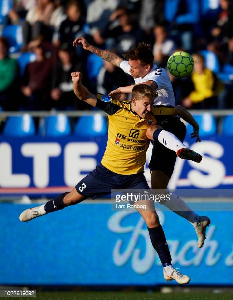 Jesper Boge of Hobro IK and Jakob Ankersen of AGF Aarhus compete for the ball during the Danish Superliga match between Hobro IK and AGF Aarhus at DS...