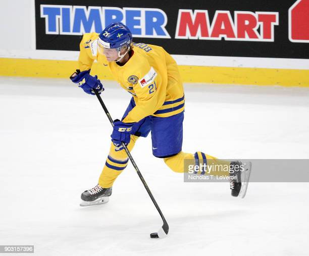 Jesper Boqvist of Sweden shoots the puck against the United States during the first period of play in the IIHF World Junior Championships Semifinal...
