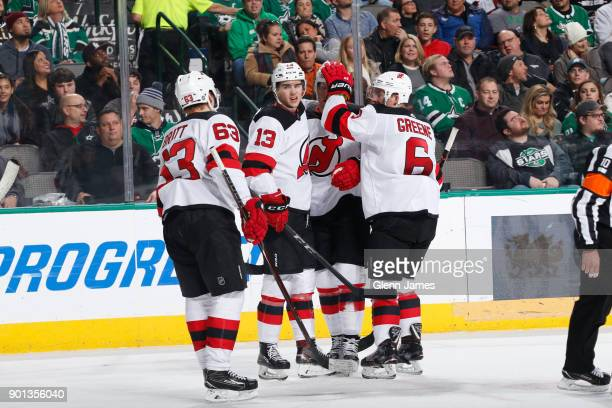Jesper Bratt Nico Hischier Andy Greene and the New Jersey Devils celebrate a goal against the Dallas Stars at the American Airlines Center on January...