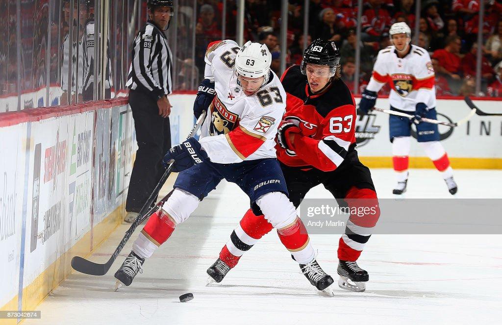 premium selection 4343a 18da2 Jesper Bratt of the New Jersey Devils and Evgenii Dadonov of ...