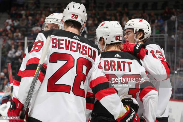 Jesper Bratt of the New Jersey Devils celebrates a goal against the Colorado Avalanche with teammates Damon Severson Nico Hischier and John Moore at...