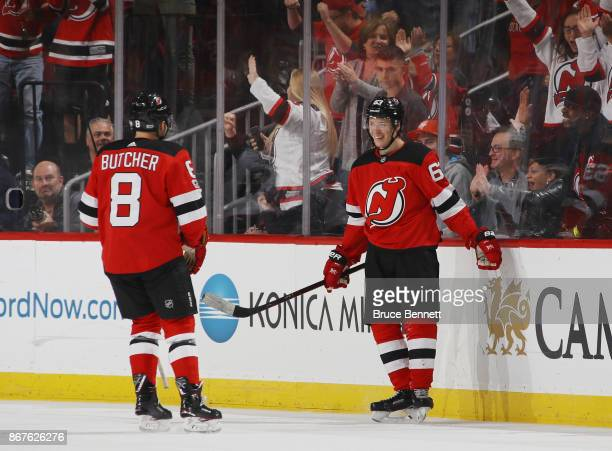 Jesper Bratt of the New Jersey Devils celebrates his game winning powerplay goal at 1547 of the third period against the Arizona Coyotes and is...