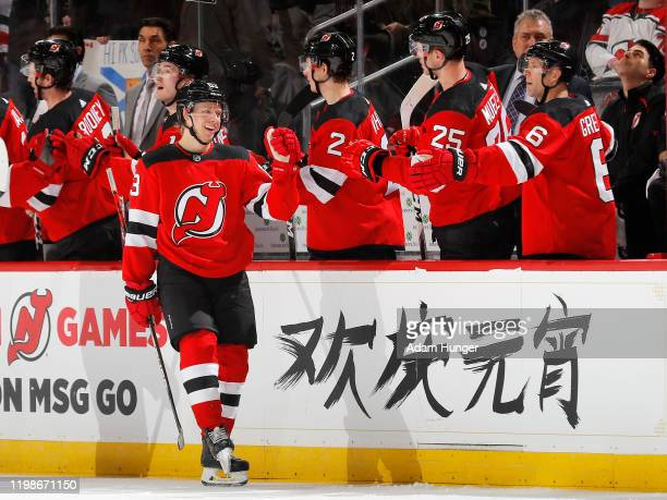 Jesper Bratt of the New Jersey Devils is congratulated as he returns to the bench after scoring a second period goal against the Montreal Canadiens...