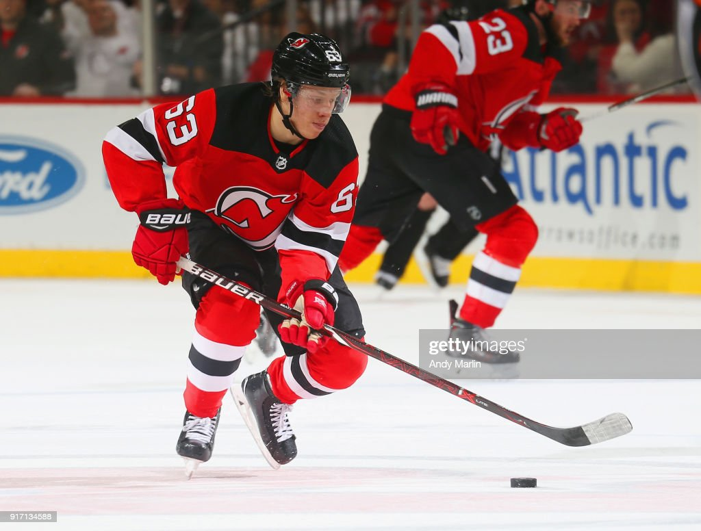 Jesper Bratt #63 of the New Jersey Devils plays the puck against the Boston Bruins during the game at Prudential Center on February 11, 2018 in Newark, New Jersey.