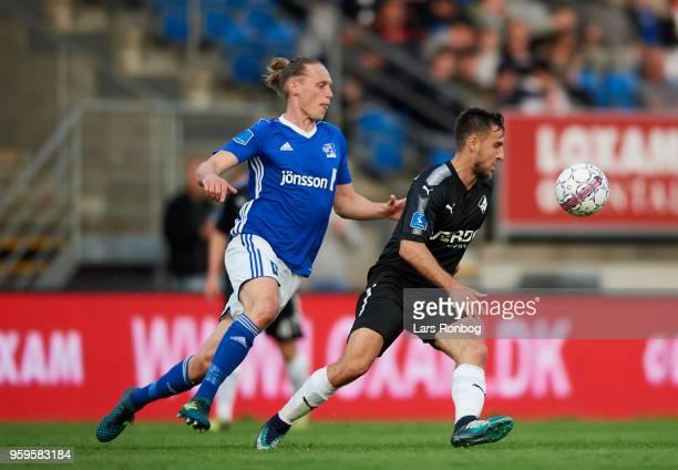 Jesper Christjansen of Lyngby BK and Bashkim Kadrii of Randers FC compete for the ball during the Danish Alka Superliga match between Lyngby BK and...