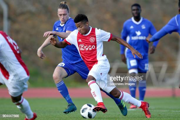 Jesper Christjansen of Lyngby David Neres of Ajax during the match between Ajax v Lyngby BK at the Estadio Municipal on January 13 2018 in Albufeira...