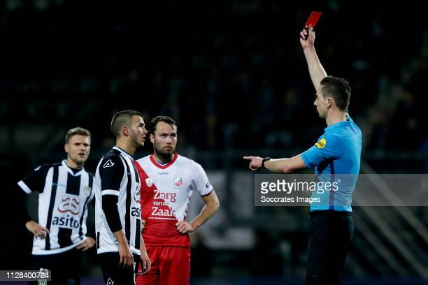 Jesper Drost of Heracles Almelo receives a red card from referee Christiaan Bax during the Dutch Eredivisie match between Heracles Almelo v FC...