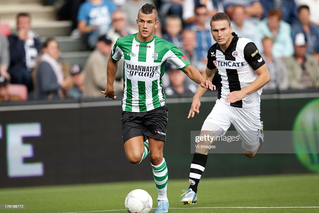 Jesper Drost of PEC Zwolle (L) Bart Schenkeveld of Heracles Almelo (R) during the Eredivisie match between Heracles Almelo and PEC Zwolle on August 10, 2013 at the Polman stadium at Almelo, The Netherlands.