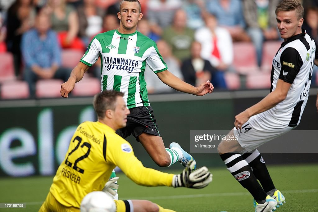 Jesper Drost of PEC Zwolle (L) Ben Rienstra (R) Remko Pasveer (L) of Heracles Almelo during the Eredivisie match between Heracles Almelo and PEC Zwolle on August 10, 2013 at the Polman stadium at Almelo, The Netherlands.