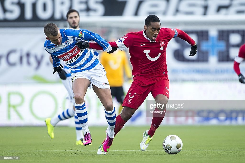 Jesper Drost of PEC Zwolle. Leroy Fer of FC Twente during the Dutch Eredivisie match between PEC Zwolle and FC Twente at the IJsseldelta Stadium on february 10, 2013 in Zwolle, The Netherlands