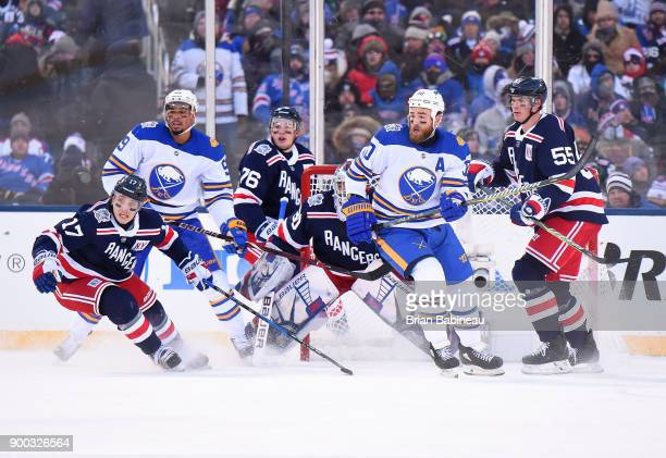 Jesper Fast Brady Skjei goaltender Henrik Lundqvist and Nick Holden of the New York Rangers and Evander Kane and Ryan O'Reilly of the Buffalo Sabres...